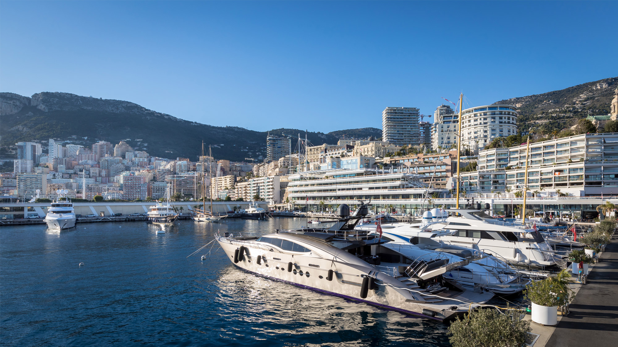 Side view of yachts and Monaco real estate in Port Hercule, Monaco