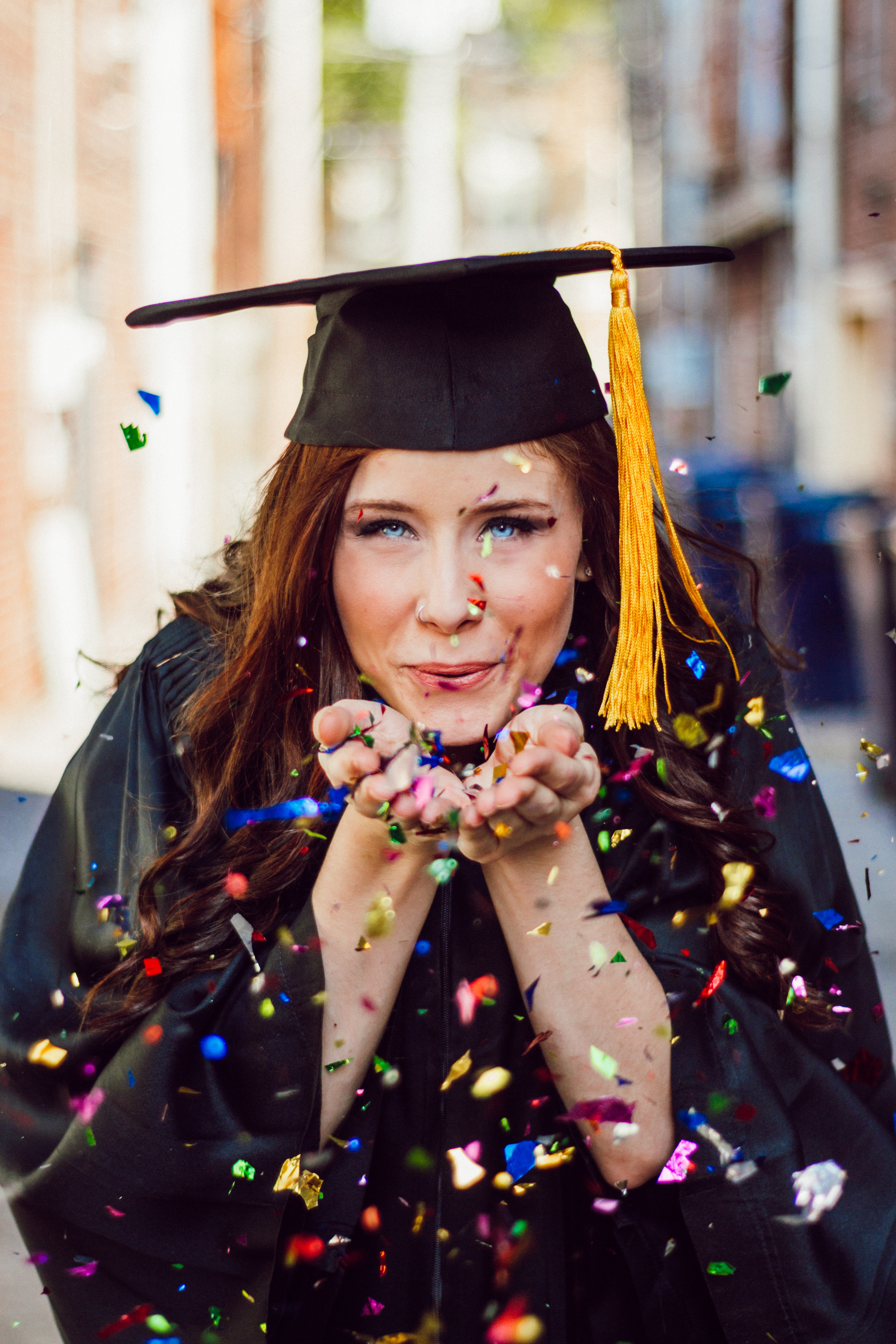 The IUM Graduation 2019 | Monaco Students - Student blowing confetti - Miells